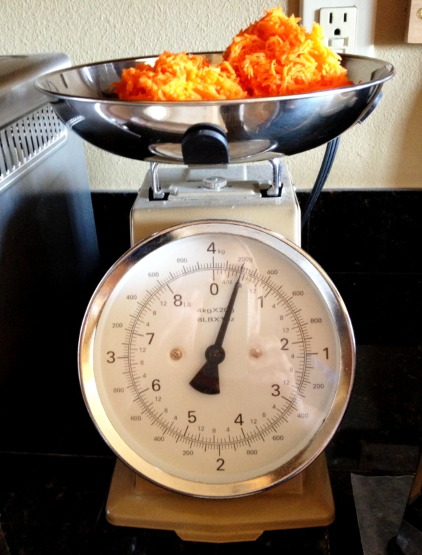 Start with 1 1/2 cups grated carrots, or about 7 ounces.